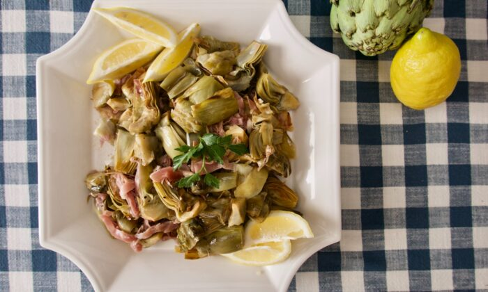 Braised until tender and mixed with salty shreds of Spanish ham, these artichokes are worth the work. (Victoria de la Maza)