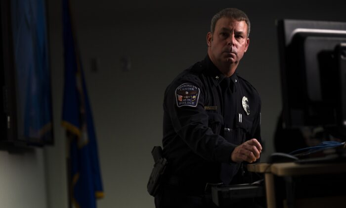 Brooklyn Center Police Chief Tim Gannon looks on as the video of an officer shooting Daunte Wright is played during a press conference at police headquarters in Brooklyn Center, Minn., on April 12, 2021. (Stephen Maturen/Getty Images)