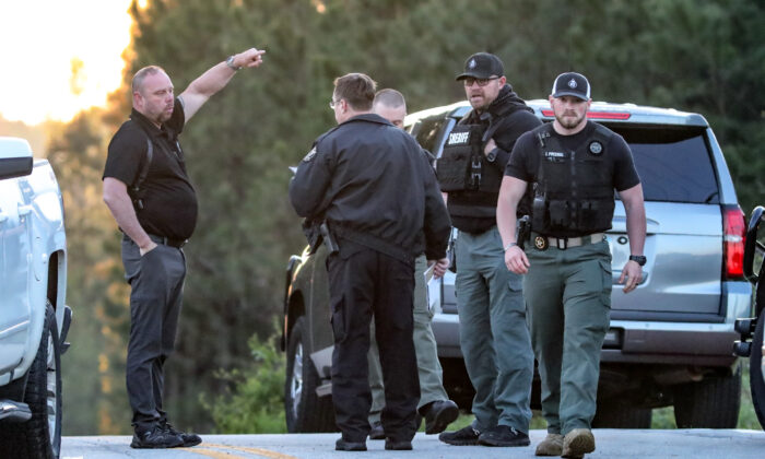 Law enforcement work the scene scene following a police chase in Carroll County, Ga., on April 12, 2021. (John Spink/Atlanta Journal-Constitution via AP)