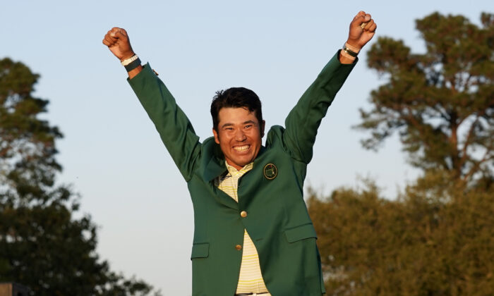 Hideki Matsuyama, of Japan, celebrates after putting on the champion's green jacket after winning the Masters golf tournament in Augusta, Ga., on April 11, 2021. (Gregory Bull/AP Photo)