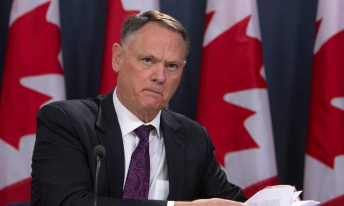 David McGuinty, chair of the National Security and Intelligence Committee of Parliamentarians, holds a new conference to release the committee's annual report, in Ottawa on March 12, 2020. (Fred Chartrand/The Canadian Press)
