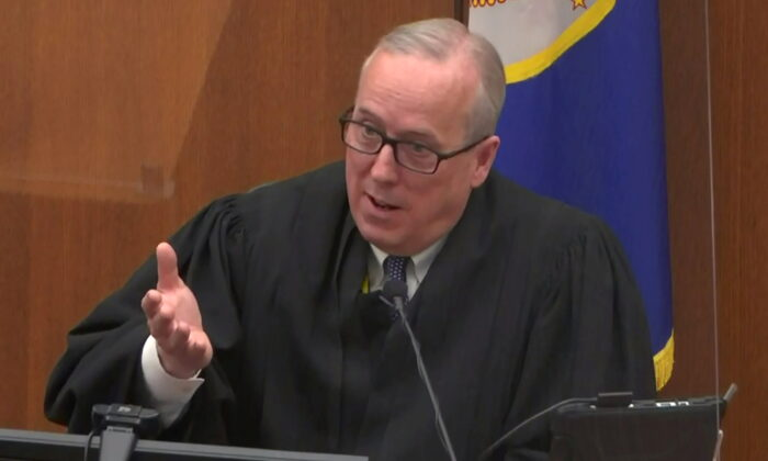 In a still image from video, Hennepin County District Judge Peter Cahill speaks with legal teams on the 11th day of the trial of former Minneapolis police officer Derek Chauvin for second-degree murder, third-degree murder and second-degree manslaughter in the death of George Floyd in Minneapolis, on April 12, 2021. (Pool via Reuters)