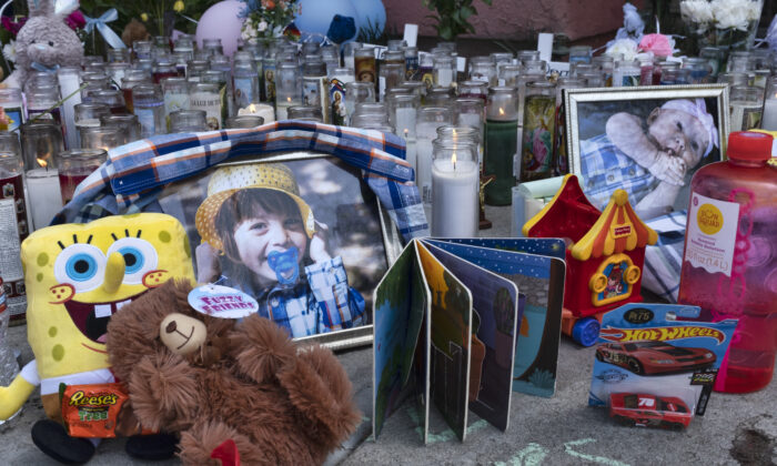 Photos, candles, flowers and balloons are placed as a memorial for three children who were killed at the Royal Villa apartments complex in the Reseda section of Los Angeles, on April 12, 2021. (Richard Vogel/AP Photo)