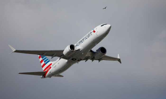 An American Airlines flight takes off from Miami, Fla., on Dec. 29, 2020.  (Marco Bello/Reuters)