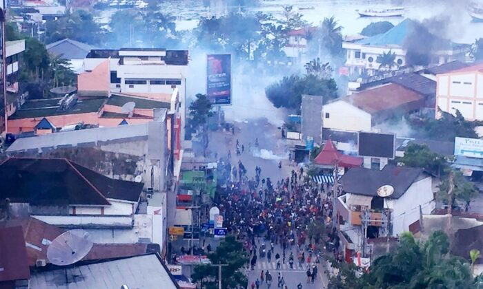 Hundreds of demonstrators marched near Papua's biggest city of Jayapura on August 29, 2019, where they set fire to a regional assembly building and hurled rocks at shops and hotels. (Cleine/AFP via Getty Images)