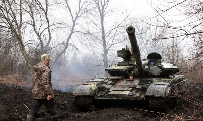 Ukrainian servicemen with their tank close to the front line of clashes with Russian-backed separatists near Lysychansk, Ukraine, on April 7, 2021. (STR/AFP via Getty Images)