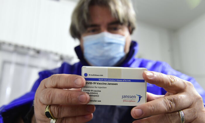 A box of Janssen vaccines is shown by pharmacist Zsolt Szenasi at a warehouse of Hungaropharma, a Hungarian pharmaceutical wholesale company, in Budapest, Hungary, after the arrival of the first batch of the Johnson & Johnson, made one-dose vaccine against the new coronavirus in the country, on April 13, 2021. (Szilard Koszticsak/MTI via AP)