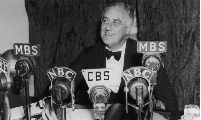 President Franklin D. Roosevelt seated in front of a number of television and radio station microphones in Washington, D.C., on Oct. 14, 1938. (Fotosearch/Getty Images)