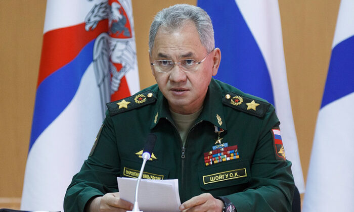Russian Defense Minister Sergei Shoigu speaks as he visits a naval base in Gadzhiyevo, Russia on Tuesday, April 13, 2021. (Vadim Savitsky/Russian Defense Ministry Press Service via AP)