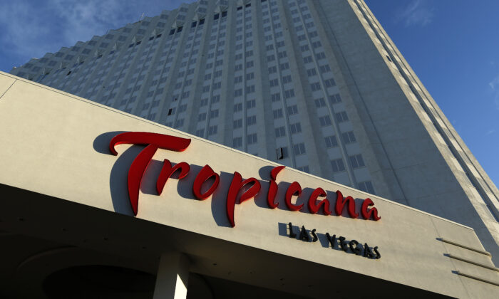 Sunlight illuminates a sign at the Tropicana hotel and casino in Las Vegas, Nev., on Aug. 4, 2015. (John Locher/AP Photo)