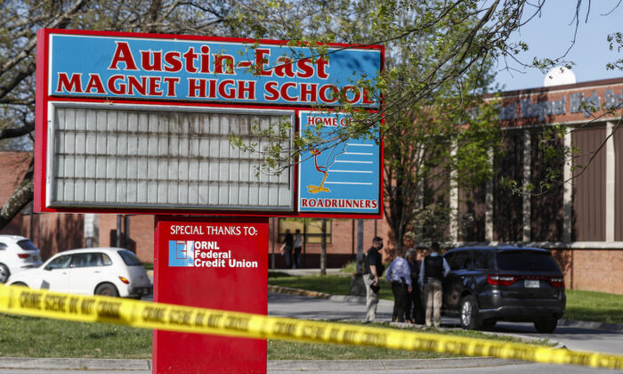 Knoxville police work the scene of a shooting at Austin East High School in Knoxville, Tenn., on April 12, 2021. (AP Photo/Wade Payne)