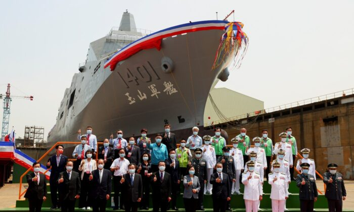 "Taiwan's President Tsai Ing-wen poses for a group photo in front of Taiwan Navy's domestically built amphibious transport dock ""Yushan"" during its launching ceremony in Kaohsiung, Taiwan, on April 13, 2021. (Ann Wang/Reuters)"