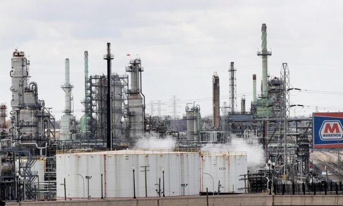 Storage tanks are shown at the Marathon Petroleum Corp. refinery in Detroit, on April 21, 2020. (AP Photo/Paul Sancya)