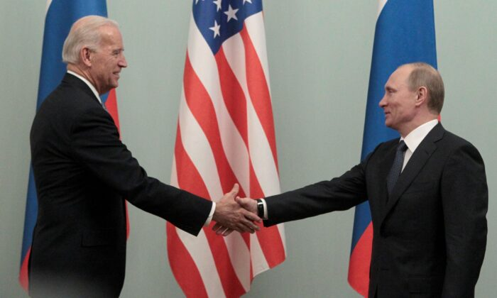 File photo showing then Russian Prime Minister Vladimir Putin shaking hands with then U.S. Vice President Joe Biden, in Moscow on March 10, 2011. (Alexander Natruskin/Reuters)