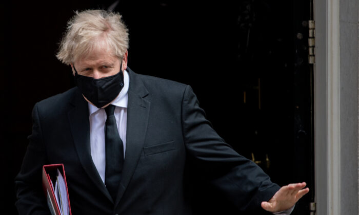British Prime Minister Boris Johnson leaves for the first Prime Ministers Questions after the Easter Recess at Downing Street in London, on Apr. 14, 2021. (Chris J Ratcliffe/Getty Images)