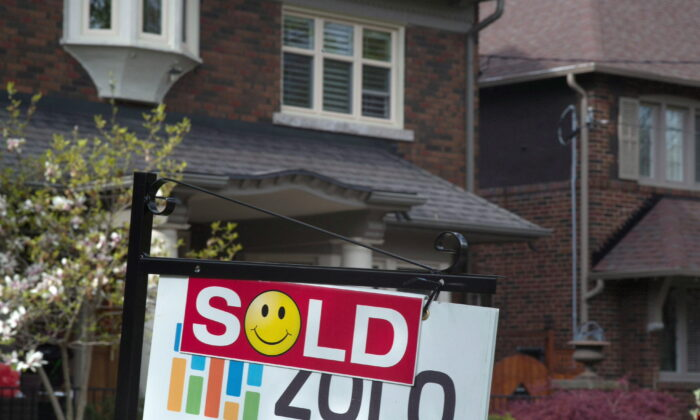 A sold sign is displayed in front of west-end Toronto homes in this file photo. (The Canadian Press/Graeme Roy)