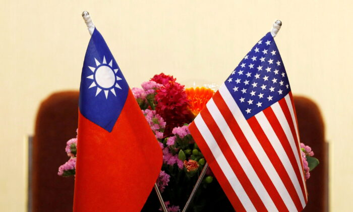 Flags of Taiwan and the United States are placed for a meeting in Taipei, Taiwan, on March 27, 2018. (Tyrone Siu/Reuters)