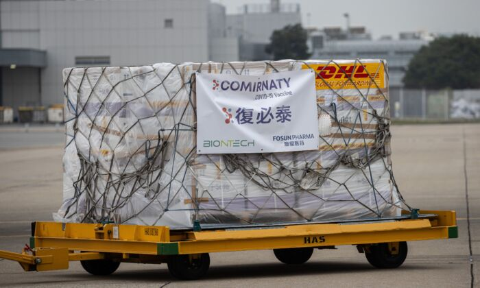 A trolley carrying Pfizer-BioNTech COVID-19 coronavirus vaccines is transported to a warehouse after being unloaded from a Cathay Pacific cargo plane at Hong Kong International Airport in Hong Kong on Feb. 27, 2021. (Jerome Favre/POOL/AFP via Getty Images)