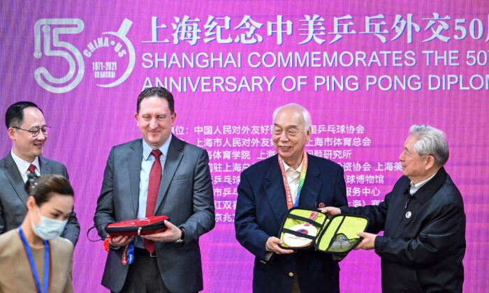 U.S. Consul General in Shanghai James Heller (2nd L) with former Chinese table tennis player Zhang Xielin (2nd R) during a ceremony to mark the 50th anniversary of Ping-Pong Diplomacy at the International Table Tennis Federation museum in Shanghai on April 10, 2021. (Hector Retamal/AFP via Getty Images)