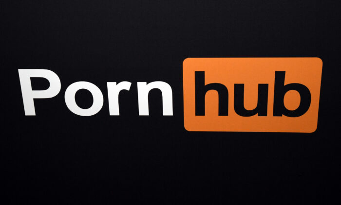 A Pornhub logo is displayed at the company's booth during an expo in Las Vegas on Jan. 24, 2018.  (Ethan Miller/Getty Images)