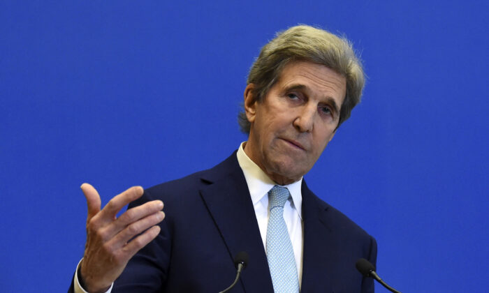 U.S. Special Presidential Envoy for Climate John Kerry gestures as he addresses a press conference after a meeting with France's Economy and Finance Minister at The Ministry of Economy in Paris, France, on March 10, 2021. (Eric Piermont/AFP via Getty Images)