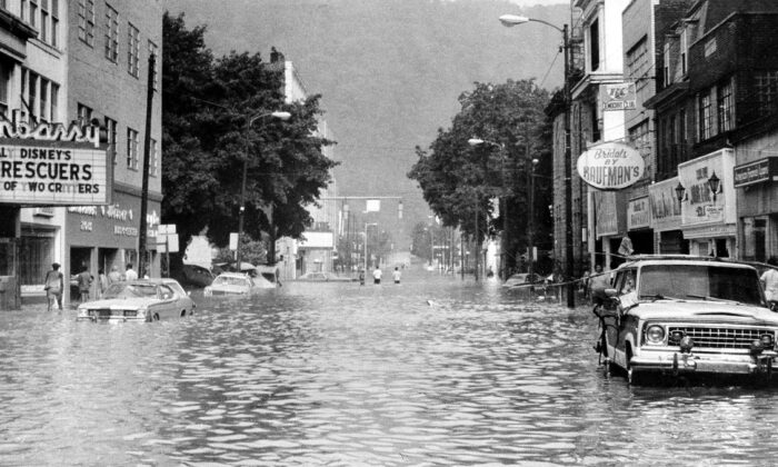 This is a general view of Main Street in downtown Johnstown, Pa., Wednesday morning, July 20, 1977 after floodwaters began to recede. Heavy rain and the breaking of a dam caused the city to be flooded. (AP Photo)