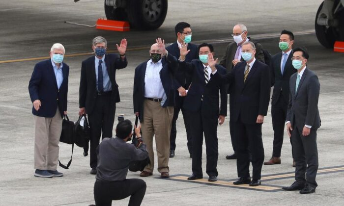 From left, former U.S. senator Chris Dodd, former U.S. Deputies Secretary of State James Steinberg and Richard Armitage have their photo taken with Taiwan Foreign Minister Joseph Wu upon arrival in Taipei, Taiwan, on April 14, 2021. (Central News Agency via Reuters)