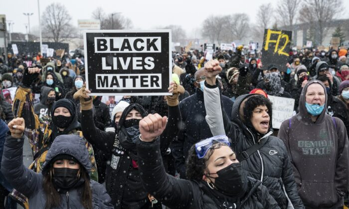 Demonstrators march to Brooklyn Center Police Department to protest the fatal shooting of Daunte Wright during a traffic stop in Brooklyn Center, Minn. onApril 13, 2021. (John Minchillo/AP Photo)