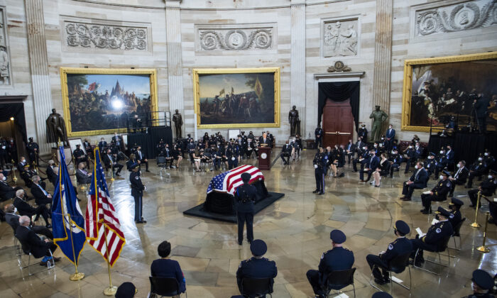 President Joe Biden speaks during the service for U.S. Capitol Officer William Evans, as his remains lie in honor in the Capitol Rotunda in Washington, on April 13, 2021. (Tom Williams/CQ Roll Call/Pool)