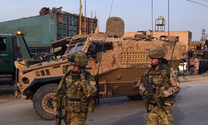 British soldiers are pictured at the scene of a suicide attack on a European Union police vehicle along the Kabul-Jalalabad road in Kabul, Afghanistan, on Jan. 5, 2015. (Wakil Kohsar/AFP via Getty Images)