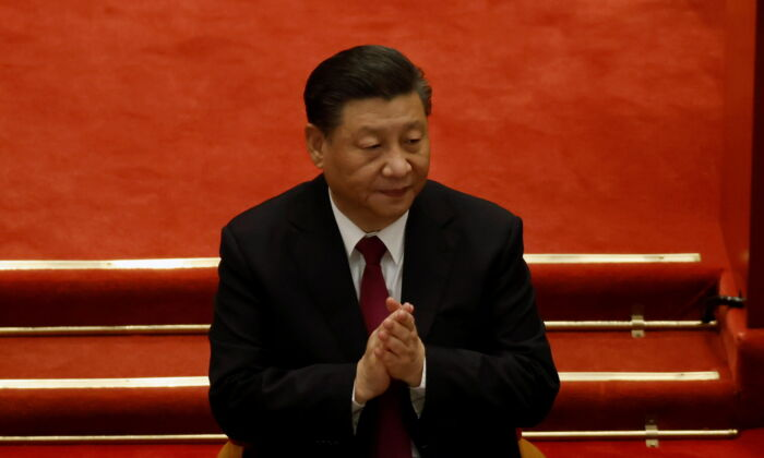 Chinese leader Xi Jinping applauds at the Great Hall of the People in Beijing, China, on March 10, 2021. (Carlos Garcia Rawlins/Reuters)