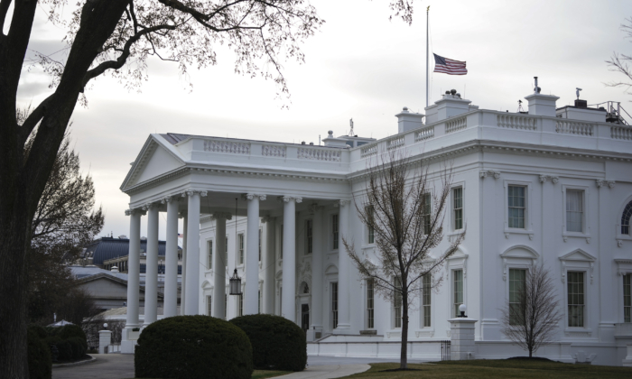 The American flag flies at half-staff at the White House in honor of Atlanta shooting victims on March 19, 2021 in Washington. (Drew Angerer/Getty Images)