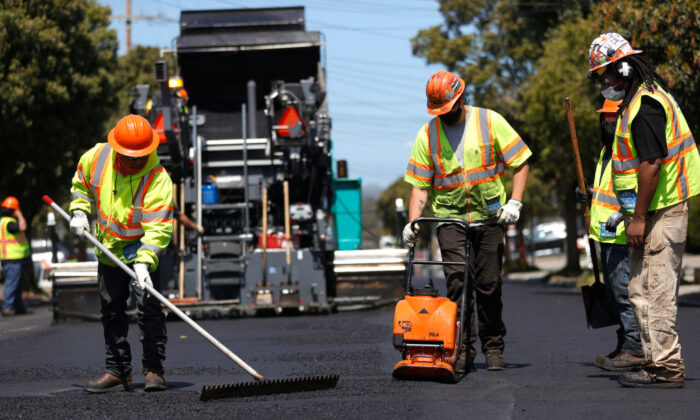 Workers with the San Francisco Department of Public Works repave a section of 24th Avenue in San Francisco, Calif., on April 8, 2021. (Justin Sullivan/Getty Images)