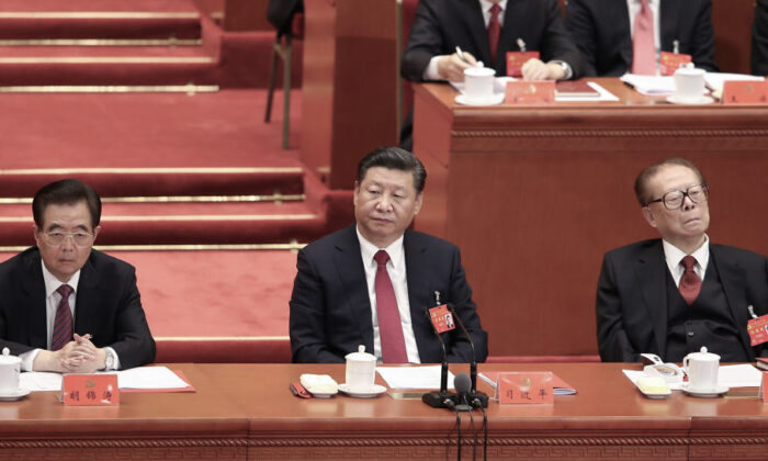 (L-R) China's former leader Hu Jintao, Xi Jinping, and former leader Jiang Zemin attend the closing of the 19th Communist Party Congress at the Great Hall of the People in Beijing, China on Oct. 24, 2017. (Lintao Zhang/Getty Images)