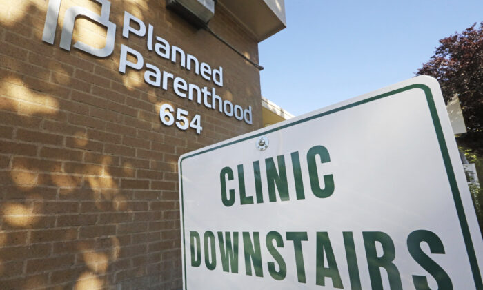 A sign is displayed at Planned Parenthood of Utah in Salt Lake City on Aug. 21, 2019. (Rick Bowmer/AP Photo)