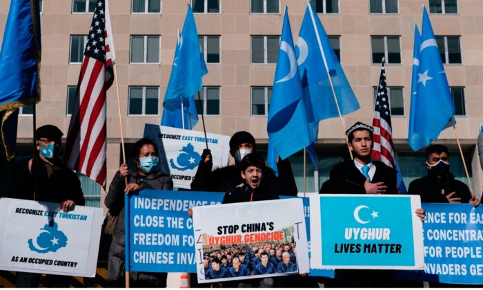 Uyghurs of the East Turkistan National Awakening Movement (ETNAM) hold a rally outside the U.S. State Department calling on U.S. President Joe Biden to increase pressure on the Chinese Communist Party, in Washington on Feb. 5, 2021. (Alex Edelman/AFP via Getty Images)