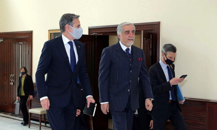 Abdullah Abdullah, Chairman of the High Council for National Reconciliation (C) walks with U.S. Secretary of State Antony Blinken, at the Sapidar Palace in Kabul, Afghanistan, on April 15, 2021. (Sapidar Palace via AP)