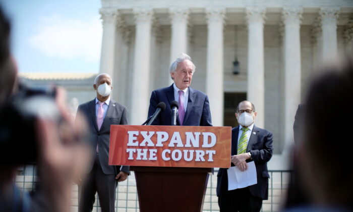 Sen. Ed Markey (D-Mass.), center, and Reps. Hank Johnson (D-Ga.), and Jerrold Nadler (D-N.Y.), introduce a bill that would add four seats to the Supreme Court, in Washington on April 15, 2021. (James Lawler Duggan/Reuters)