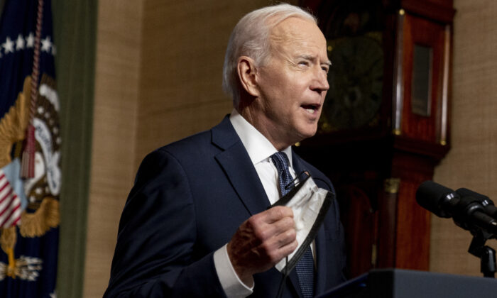 President Joe Biden removes his mask to speak from the Treaty Room in the White House about the withdrawal of the remainder of U.S. troops from Afghanistan in Washinton on April 14, 2021. (Andrew Harnik/Pool/Abacapress.com)