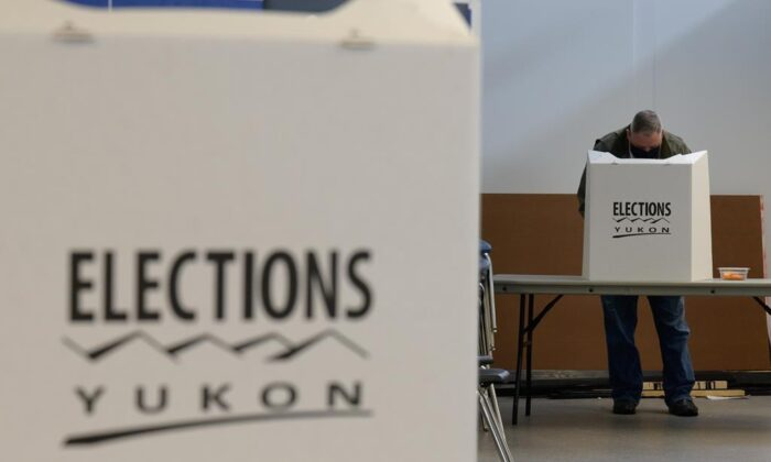 A voter is shown at a Whitehorse polling station during the Yukon election on April 12, 2021. An official count has confirmed a tie in the Yukon election, pushing the process to the next step of a judicial recount. (Mark Kelly/The Canadian Press)