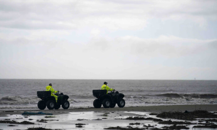 Lafourche Parish deputies patrol along the shoreline of the Gulf of Mexico, not far from where a lift boat capsized during a storm on Tuesday, killing one with 12 others still missing, on Elmer's Island, La., on Thursday, April 15, 2021. (Gerald Herbert/AP Photo)