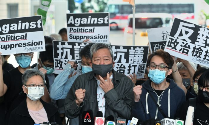 Margaret Ng, Lee Cheuk-yan, and Figo Chan, the convener of local pro-democracy group Civil Human Rights Front, outside of the West Kowloon court building in Hong Kong on April 16, 2021. (Sung Pi-lung/The Epoch Times)
