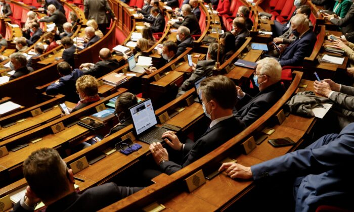 Members of Parliament attend a session of questions to the Government at the French National Assembly in Paris, on Feb. 9, 2021. (Ludovic Marin/AFP via Getty Images)