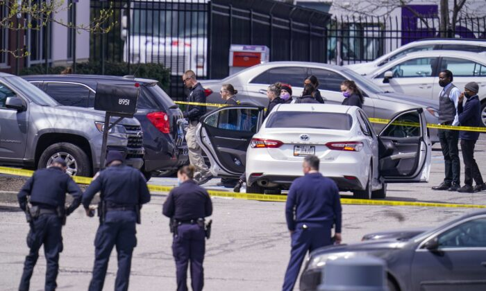 Law enforcement confer at the scene, in Indianapolis, where multiple people were shot at a FedEx Ground facility near the Indianapolis airport, on April 16, 2021. (Michael Conroy/AP Photo)