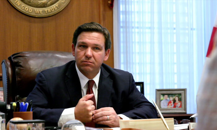 Floridа Gov. Ron DeSantis listens to a report from a member of his administration during a meeting at the governor's office in Tallahassee, Florida, on April 1, 2021. (Screenshot via Epoch Times)