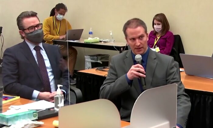 In a still image from video, former Minneapolis police officer Derek Chauvin tells the judge that he waived his right to testify to the jury, next to his defense attorney Eric Nelson, on the fourteenth day of Chauvin's trial for second-degree murder, third-degree murder and second-degree manslaughter in the death of George Floyd , in Minneapolis, Minn., on April 15, 2021. (Pool via Reuters)