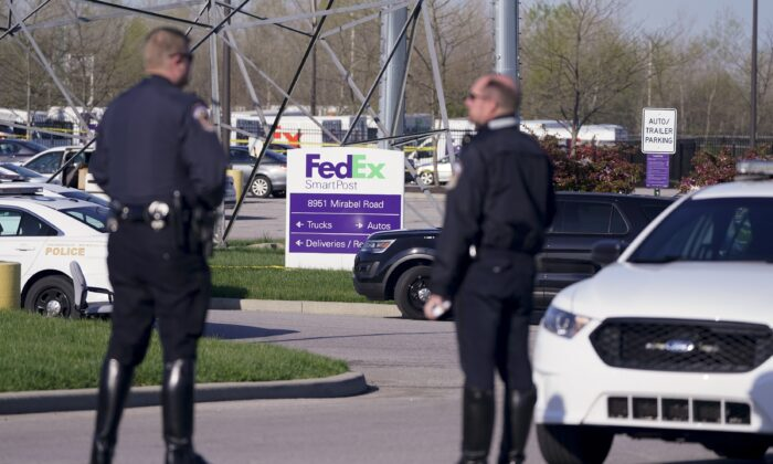 Police stand near the scene where multiple people were shot at the FedEx Ground facility in Indianapolis, Ind., on April 16, 2021. (Michael Conroy/AP Photo)
