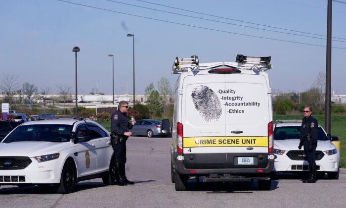 A crime scene vehicle arrives where multiple people were shot at the FedEx Ground facility in Indianapolis, early Friday morning, on April 16, 2021. (Michael Conroy/AP Photo)