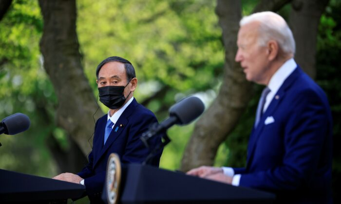 Japan's Prime Minister Yoshihide Suga and U.S. President Joe Biden hold a joint news conference in the Rose Garden at the White House in Washington, on April 16, 2021. (Tom Brenner/Reuters)