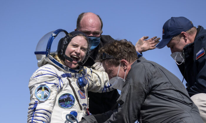 Expedition 64 NASA astronaut Kate Rubins is helped out of the Soyuz MS-17 spacecraft just minutes after she, and Roscosmos cosmonauts Sergey Kud-Sverchkov, and Sergey Ryzhikov landed in a remote area near the town of Zhezkazgan, Kazakhstan on April 17, 2021. (Bill Ingalls/NASA via AP)